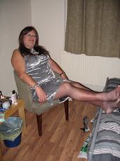 Silver dress and fishnets