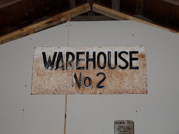 Small Sign from a Warehouse Near the Back of the Estherville Plant.