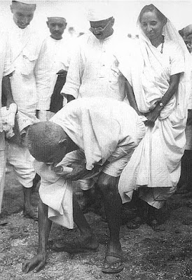 During salt Satyagraha Mahatma Gandhi picking salt on the beach at Dandi