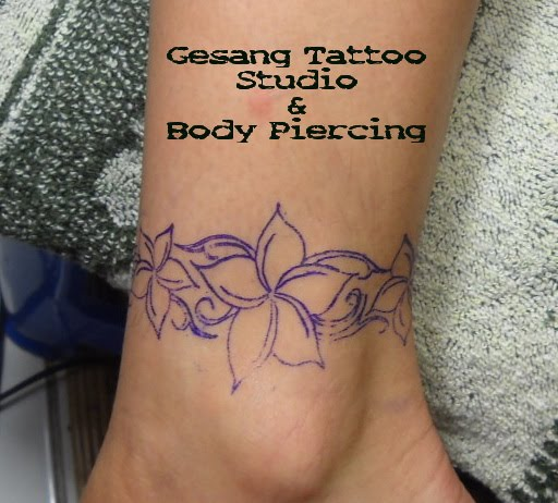 frangipani tattoo designs on foot