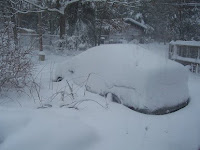 car buried in snow in Northeast Massachusetts