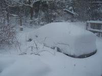 car buried in snow in Northeast Massachusetts