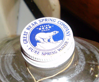 Up for sale is an antique Great Bear Spring Co. Glass Water Bottle and Shipping Crate . These are very decorative and make nice savings banks in the home. I saved enough