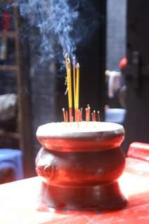 Image of burning incense in an incense burner at a shrine