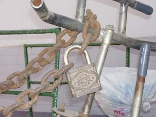 Image of one of two very large locks securing the worker's bike against theft