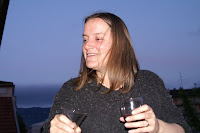 Picture of Regina pouring herself some wine on the balcony in Geneva