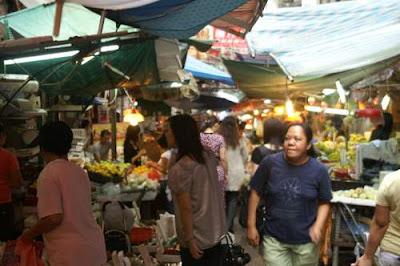 Image of people walking through a market