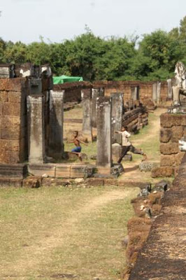 Image of kids playing amongst the laterite foundations of East Mebon, consecrated in 953, and built during the reign of Rajendravarman (944-968).