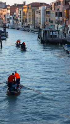 Gondoliers on the Grand Canal in Venice.