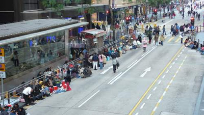 Image of Filipino domestic workers lining the streets of Hong Kong on a Sunday.