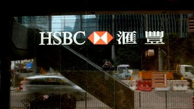 Image of HSBC's ubiquitous logo set into the marble cladding on a regular HSBC bank branch in Hong Kong.