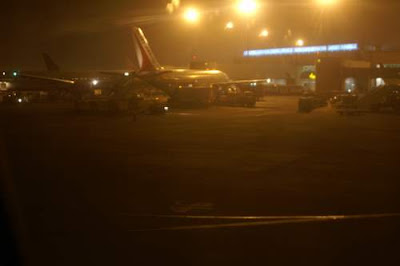 Image of plane taxing into resting place on the runway in Mumbai, India.