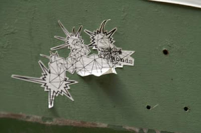 Graffiti image of a sticker graffiti of crystals and diamonds surrounded with 'power' lines from the old town centre of Genoa.