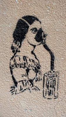 Graffiti image of an Italian woman with a gas mask on, found beside a canal in Venice, Italy.