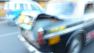 Blurred image of an Ambassador taxi, in India, taken during a bouncy ride...