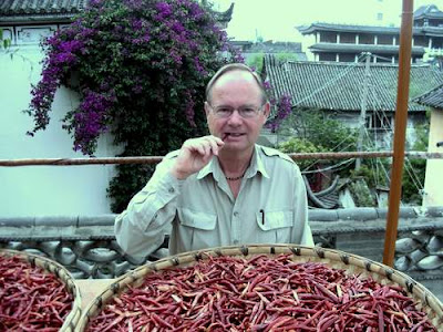 Image of your humble scribe's Dad at the dinner table in Dali, Yunnan Province, China... Sitting in front of a massive tray of dried chilli peppers...