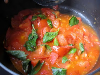 tomato sauce and sun-dried tomatoes and more tomatoes...
