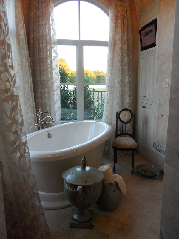 Beautiful Master bath with free standing tub, surrounded by luxurious  title=