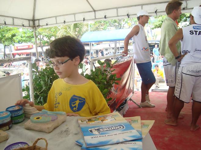 Lucas  checks out the Gomes da Costa display stand at Futevolei Mundialito in Balneario Camboriu .