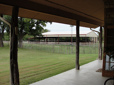 View from front porch of indoor riding arena.