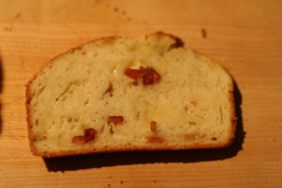a slice of bacon asiago bread