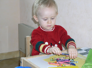 Benjamin playing with crayons