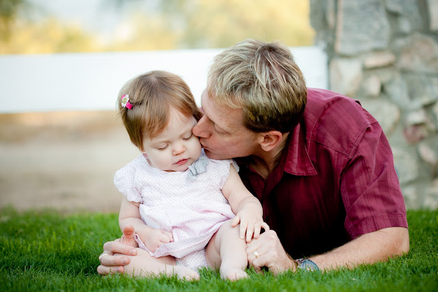 Dad kissing baby's cheek
