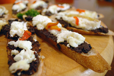 ... Bravas, Stuffed Squid, Goats Cheese and Black Olive Tapenade Crostini