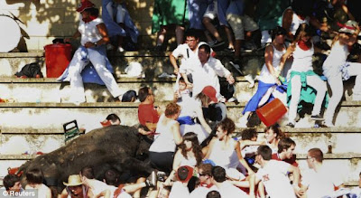 Man in a red England shirt get Weird Bull attack face to face Seen  On www.coolpicturegallery.net