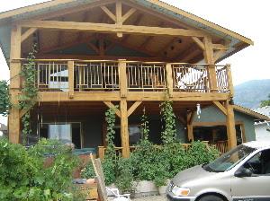 Prana timber frames timber frame porch addition for Timber frame porch addition