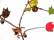 kvistar med sydda höstlöv och tovade nötter