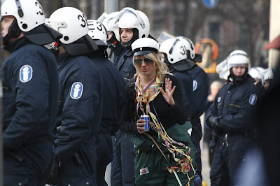 Riot police and girl in helsinki