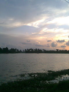 photos on Nokia Mobile taken from Thakazhy Kuttanadu Alappuzha on a rainy evening, sunset reflects in the water of paddy fields a marvelous scene