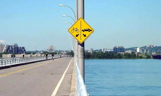 arrows allow bicycles on road and cars in water