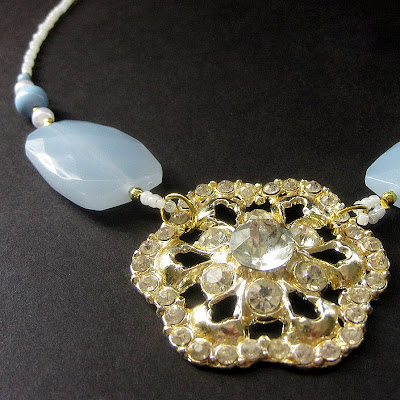 The Elegance of Snow Beaded Necklace with Antique Brooch