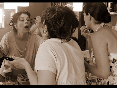 bridesmaids applying makeup