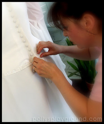 buttoning up bridal gown