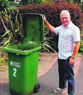 pic of man with wheelie bin