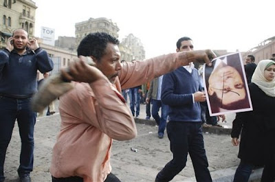 Protester Hits Mubarak Upside-down Photograph With a Shoe