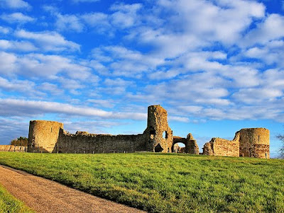 """It is doubtful whether anything of Roman structure remains in Pevensey, though much of the material used in that castle is Roman, and though the towers of that fortification are round. It is enough to remark, that after the long night of the Saxon period the town shared in the general renaissance of South England which followed the Norman Conquest."