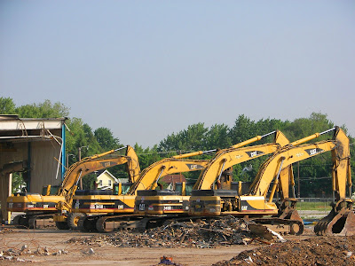 Excavators at rest near the former Haughton Elevator Company