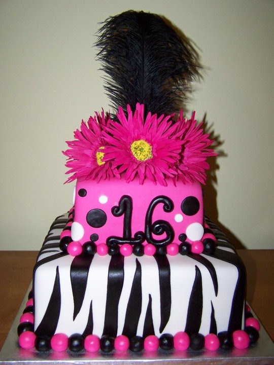 This was a sweet 16 cake, covered in mmf with faux daisies and a black plume