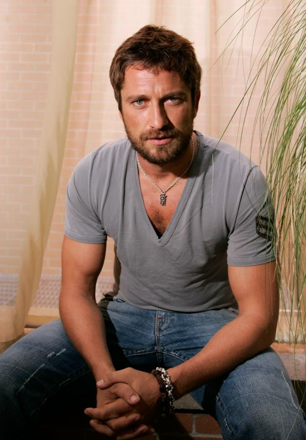 ... who has inherited his mother's blue eyes, I've gone for Gerard Butler ...