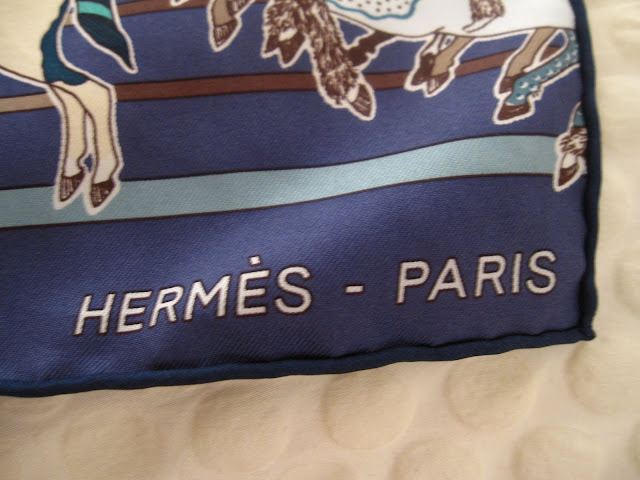 Close up of the Hermes logo on the Carre en Carres scarf