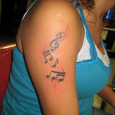 Music Tattoo Designs This is a best tattoos design and that is very nice no