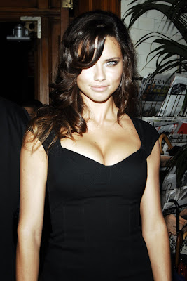 Adriana Lima in a sexy black dress
