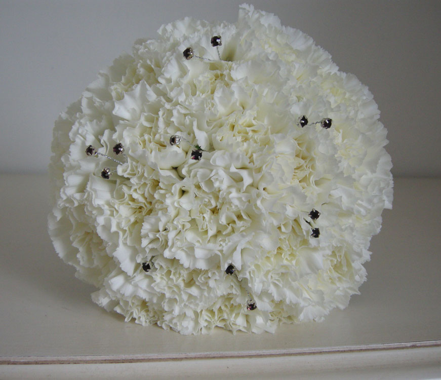 Ivory and purple bridesmaid 39s bouquet of massed carnations the detail shot