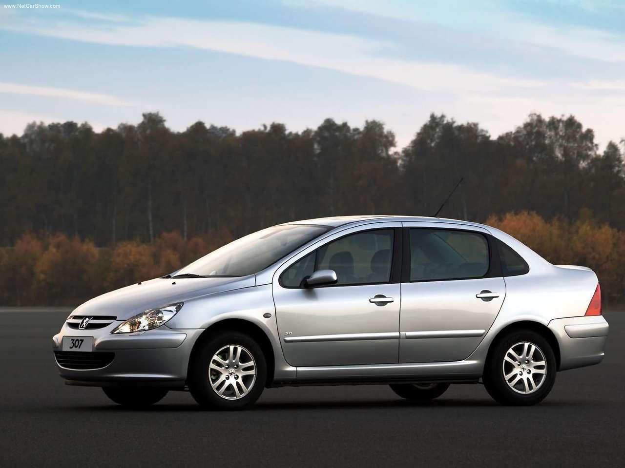 http://1.bp.blogspot.com/_xhqjRo6NERQ/S8MkeQby60I/AAAAAAAAH9o/0Zxh4TB8N14/s1600/Peugeot-307_Sedan_2.0_2004_1280x960_wallpaper_07.jpg