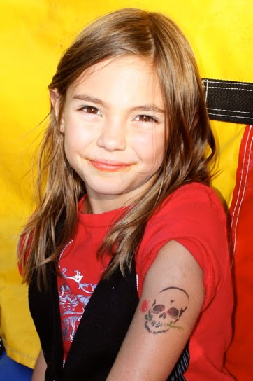 I love a girl with a pretty skull tattoo Me I like mine with butterfly