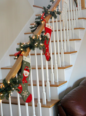Fireplaces mantles christmas wins stockings on stairs for Hang stockings staircase